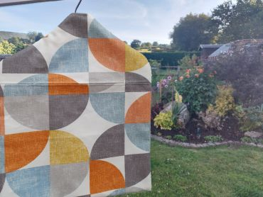 Burnt Orange, Ochre Yellow and Grey Circles Wipe Clean Oilcloth Peg Bag